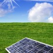 Solar energy panel against blue sky and grass - Stock Photo