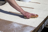 Scrubbing carpet on the dock — Stock Photo
