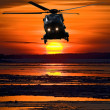 Helicopter at sunset — Stock Photo