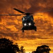 Helicopter at sunset — Stock Photo #39347925