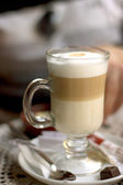 Transparent glass with latte in cafe — Stock Photo