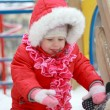 Beautiful baby playing on snow in winter — Foto Stock