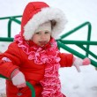 Beautiful baby playing on snow in winter — Stock Photo