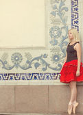 Ballerina on pointe toes in red-and-black suit — Stock Photo