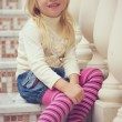 Royalty-Free Stock Photo: Girl 3 years old sitting on a beautiful staircase