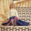 Stock Photo: Girl 3 years old sitting with shopping