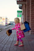 3 years old girl with shopping — Stock Photo