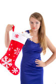 Girl holding a Christmas sock — Stock Photo
