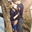 Young couple in blue dress in winter — Stock Photo