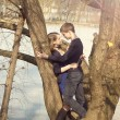 Stock Photo: Young beautiful couple hugging against tree