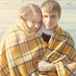Young couple winter wrapped in blanket — Stock Photo