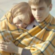 Stock Photo: Young couple with blanket