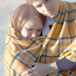 Young beautiful couple embracing in winter — Stock Photo
