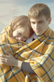 Young couple with blanket — Stock Photo