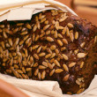 Black bread with sunflower seeds — Stockfoto