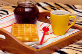 Breakfast in bed on a tray — Stockfoto