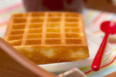 Close-up waffle and red spoon — Zdjęcie stockowe