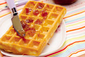 Close-up of a waffle and knife — Stock Photo