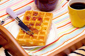 Close-up of a waffle and knife, spread the jam — Stock Photo
