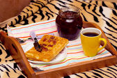 Breakfast - waffles, jam and a cup of tea — Stock Photo