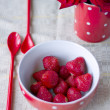 Red bowl with strawberries for breakfast — Stock Photo