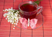 Lily of the valley and a tea — Stock Photo