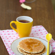 Stock Photo: Round wafers, yellow cup with spoon on napkin