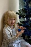 Portrait of happy girl in Christmas tree — Stock Photo