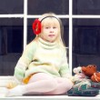 Stock Photo: Blonde little girl in knitted sweater