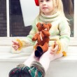 Stock Photo: Blonde little girl in knit sweater