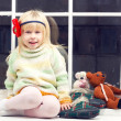 Blonde little girl in knitted sweater — Stock Photo
