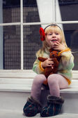 Little girl in a knitted sweater and tights — Stock Photo