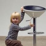 Blonde girl 3 years sat near a high chair — Stock Photo