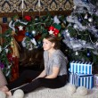 Girl with present near the Christmas tree — ストック写真