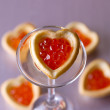 Tartlets with heart-shaped eggs — Stock Photo