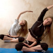 Stock Photo: Girls practicing yoga in room