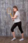 Girl with tennis racket — Stock Photo