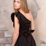 Beautiful blonde near the wall — Stock Photo #21037169