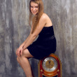 Stock Photo: Beautiful woman holding big clock