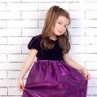 Children 5 years old in a purple dress — Stock Photo