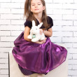 Five-year girl with white rabbit — Stock Photo