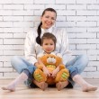Mother, daughter and soft toy - Stock Photo