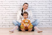 Mother, daughter and soft toy — Stock Photo