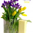 Stock Photo: Tulips and irises in vase near gift