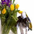 Rabbit near a bouquet - tulips and irises — Stock Photo