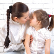 Stock Photo: Daughter kissing her mother