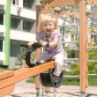 Joyful child ride on swing — Stock Photo #22056263