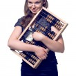 Pretty girl with abacus and money — Stock Photo