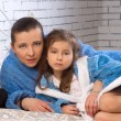 Stock Photo: Mother and daughter are in same blue robes