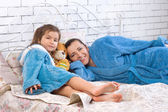 Mother and five year old daughter are in robes — Stock Photo